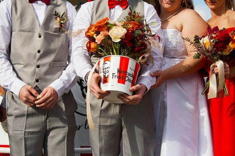 Couple put a wing on it with a KFC-themed wedding