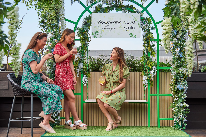 three women in garden dresses