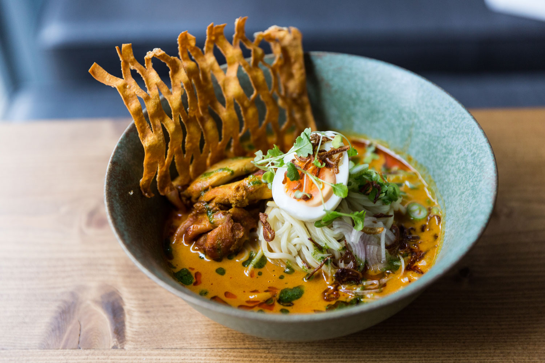 coconut chicken noodles in blue bowl