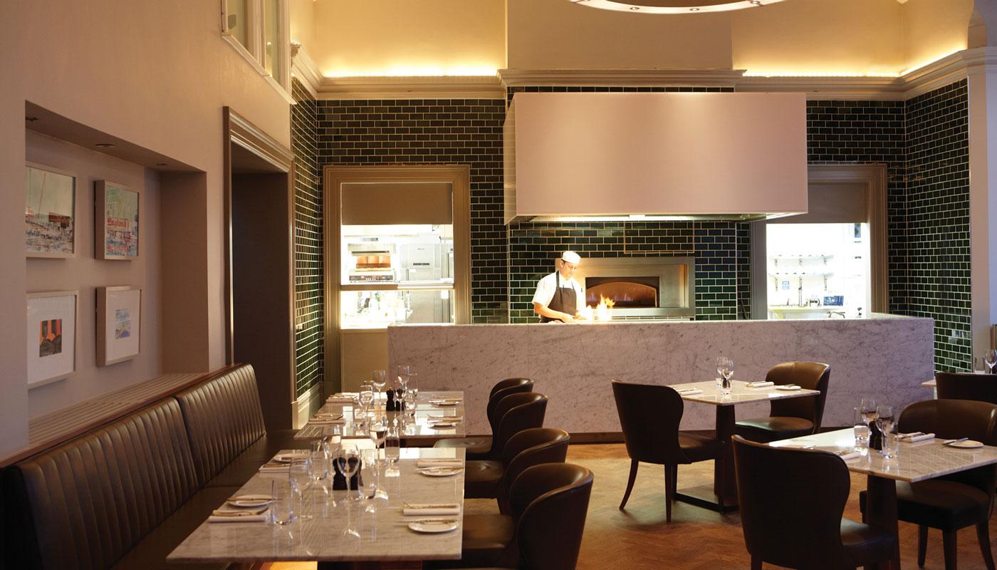 Malmaison Cheltenham interior restaurant pass with chef green tiled wall