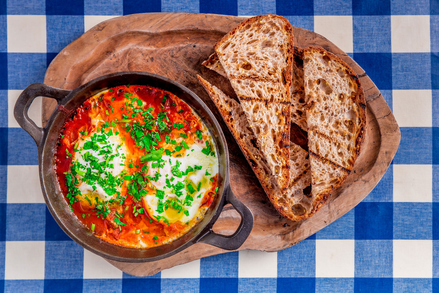 Megan's restaurants baked eggs in tomatoes with bread