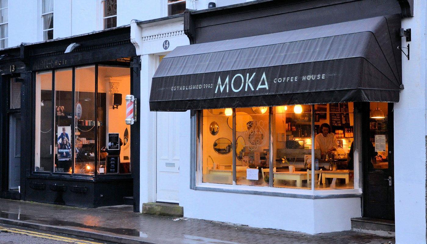 Moka cafe exterior white frontage dusk outside