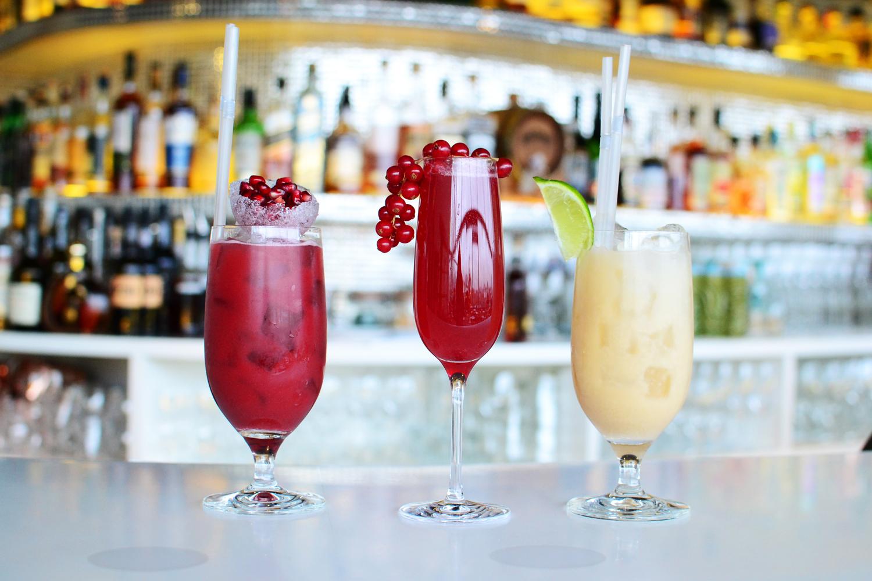 three cocktails on bar
