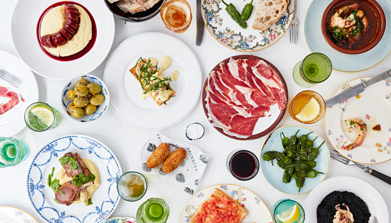 Tapas Brindisa small food plates flat lay with cutlery
