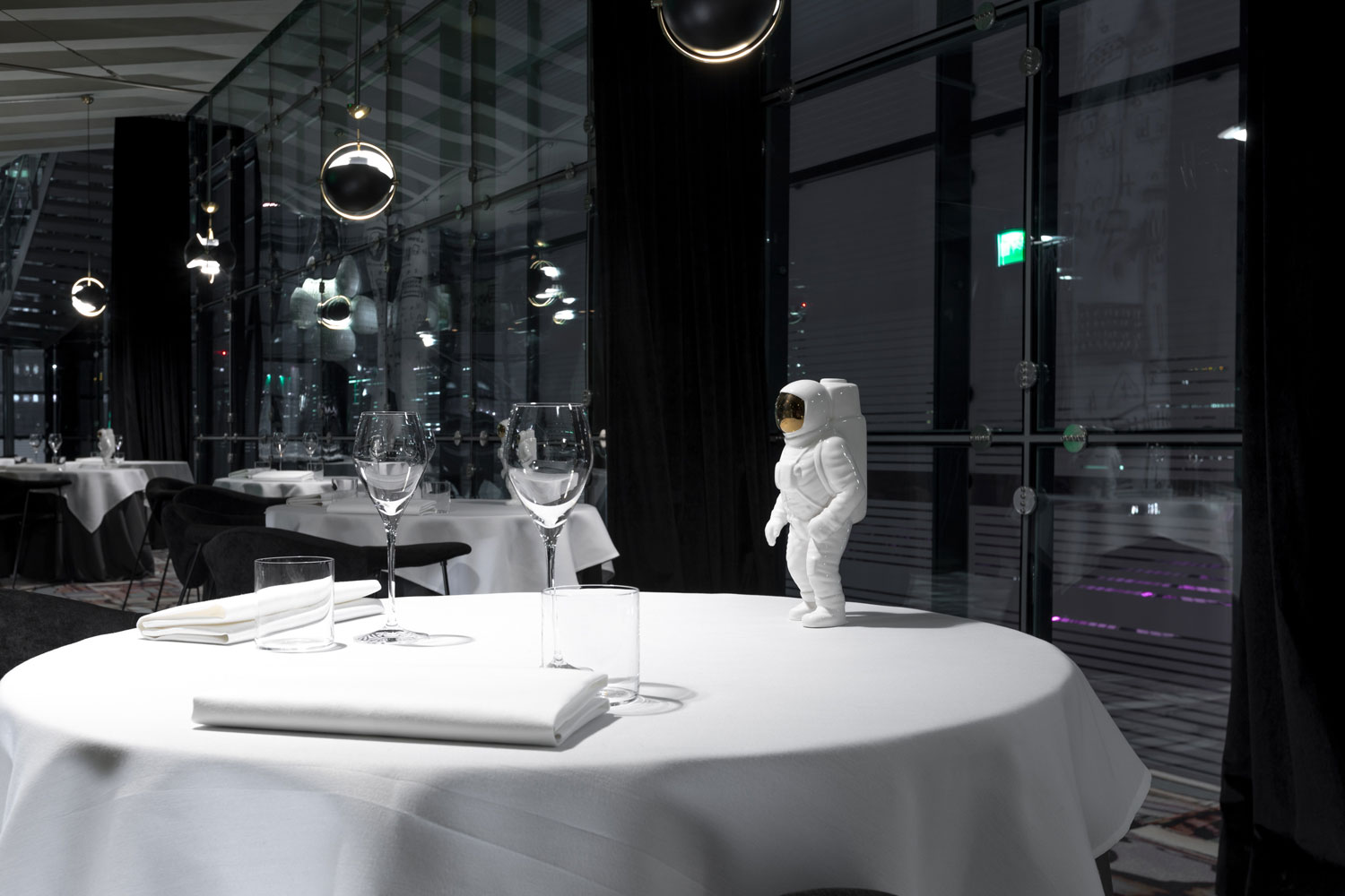 a white table with an astronaut figurine on top