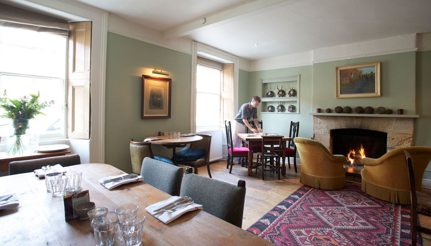The Wheatsheaf Northleach interior dining room wooden tables carpet white walls