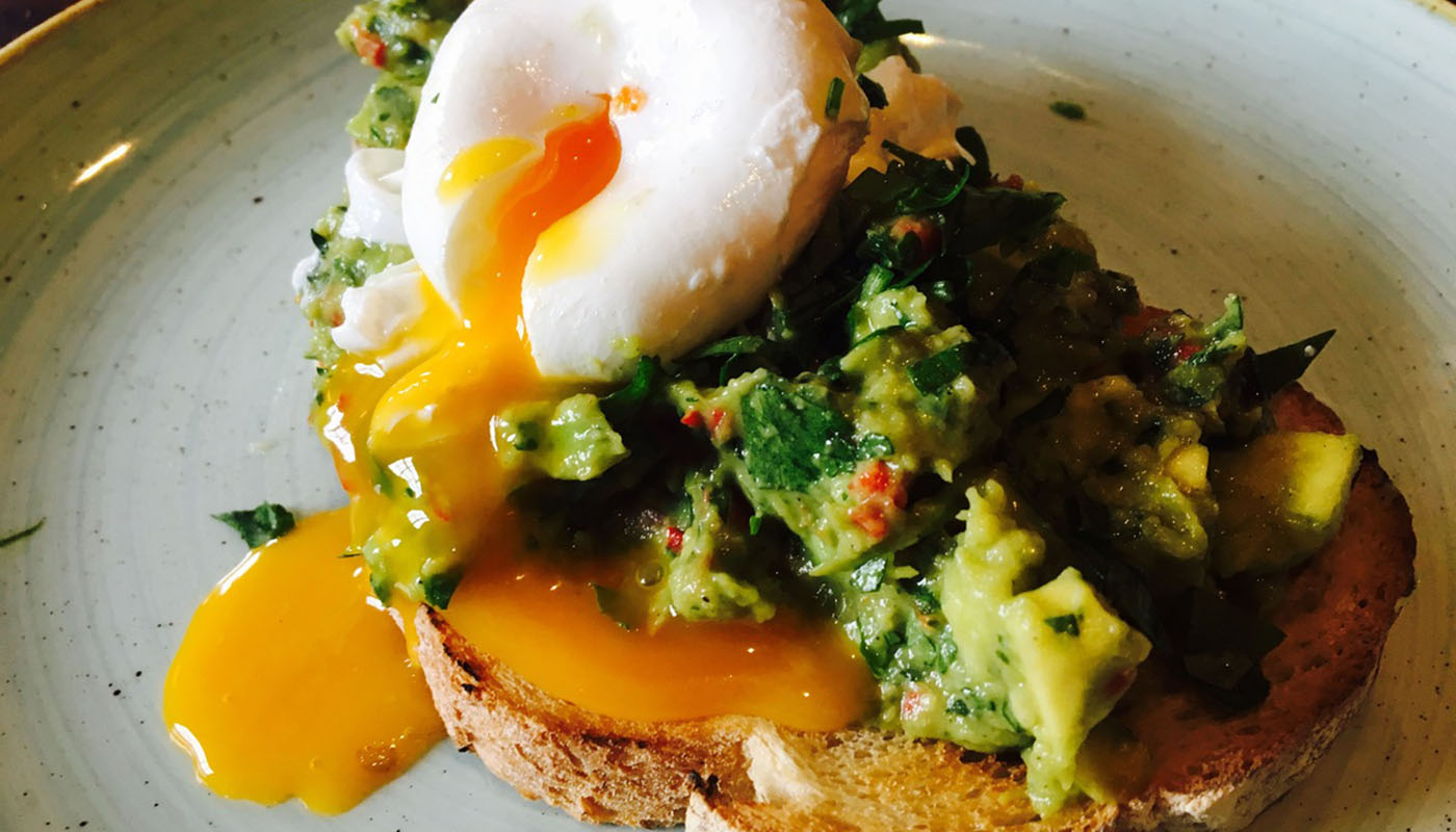 Smashed avocado and poached egg on toast at Three Cheers Pubs