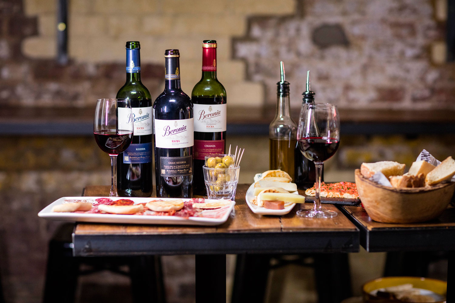 Beronia wines red wines on restaurant table with food