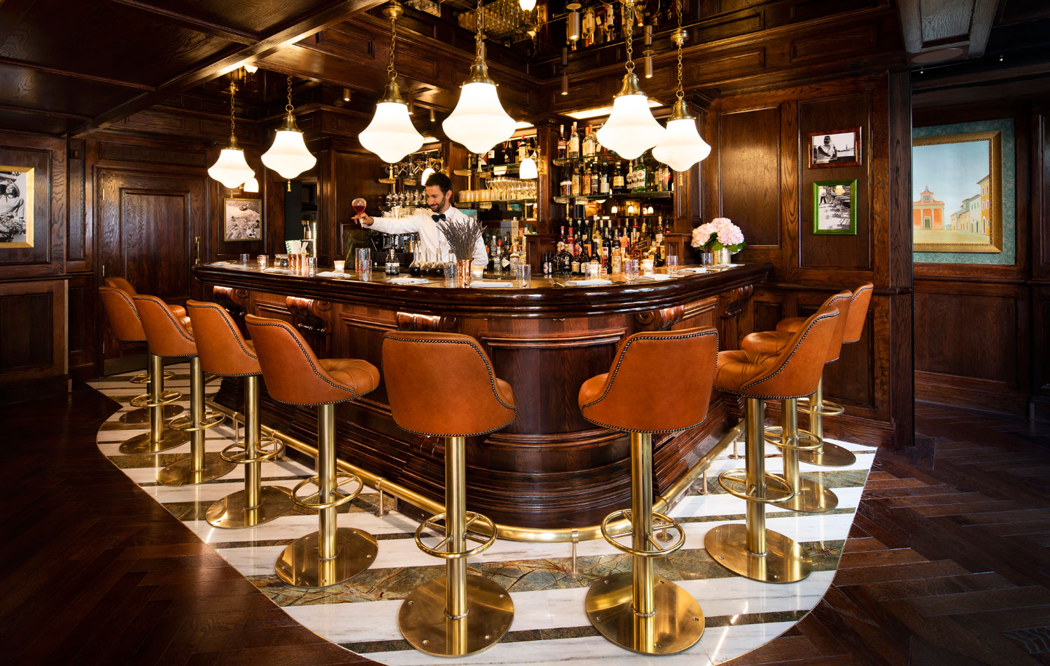 orange stool white marble bar chandeliers