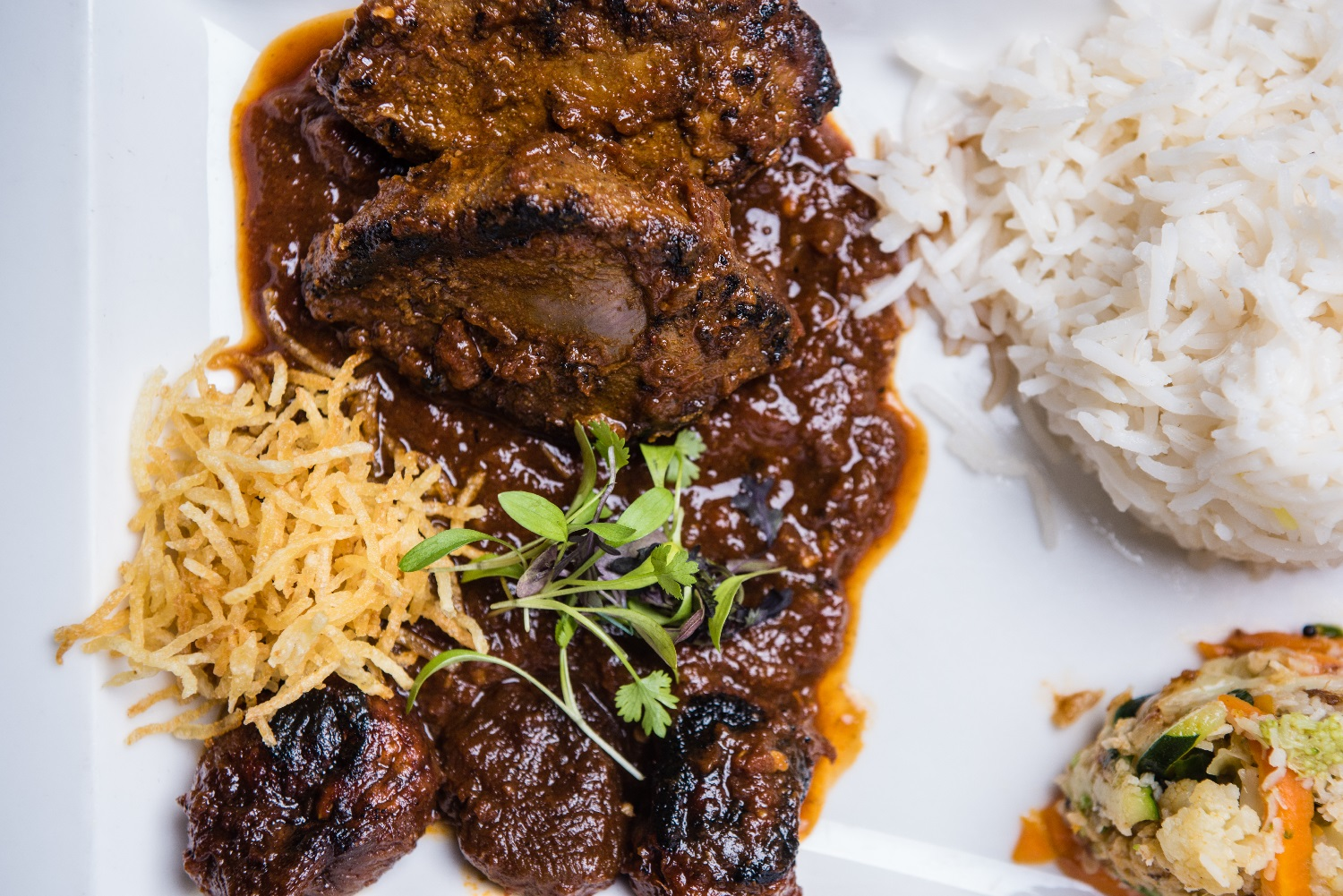 Cafe Spice Namaste grouse curry dish with rice