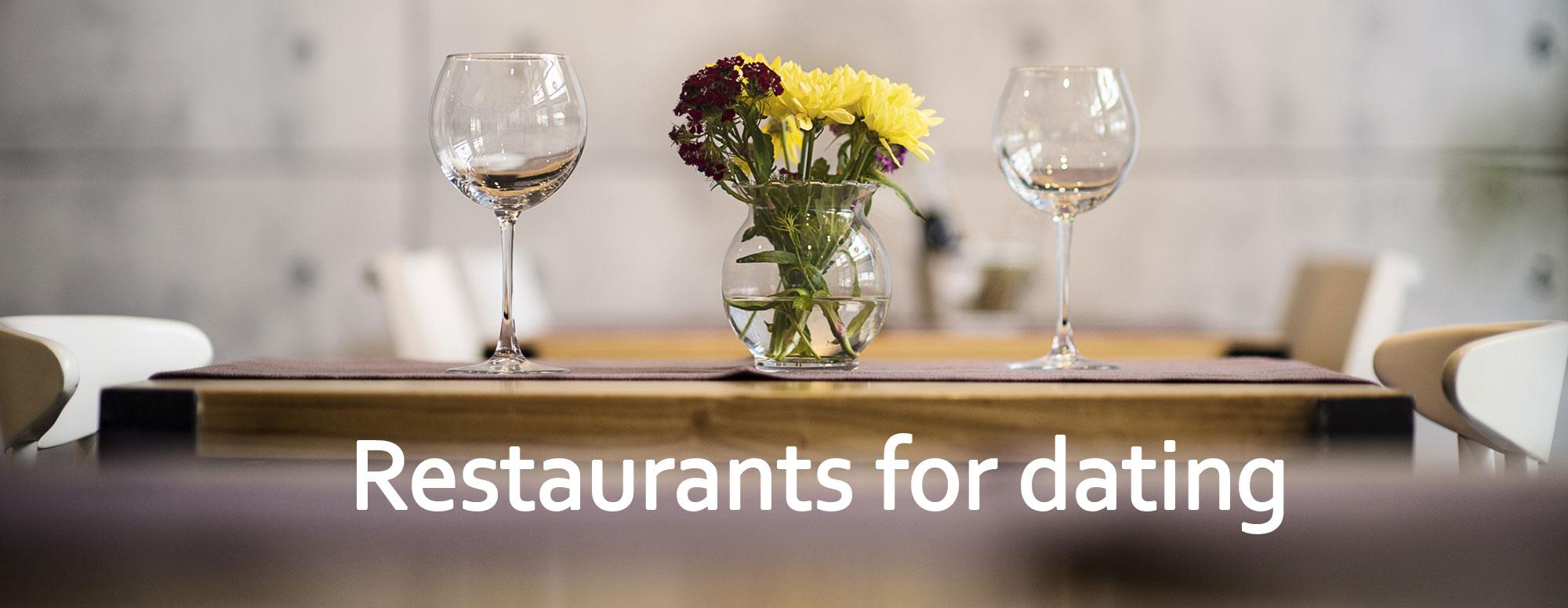 Restaurants for dating table for two flowers glasses