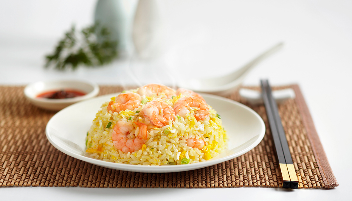 Din Tai Fung prawn fried rice dish with white background