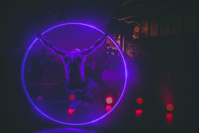 ariel performer in neon hoop