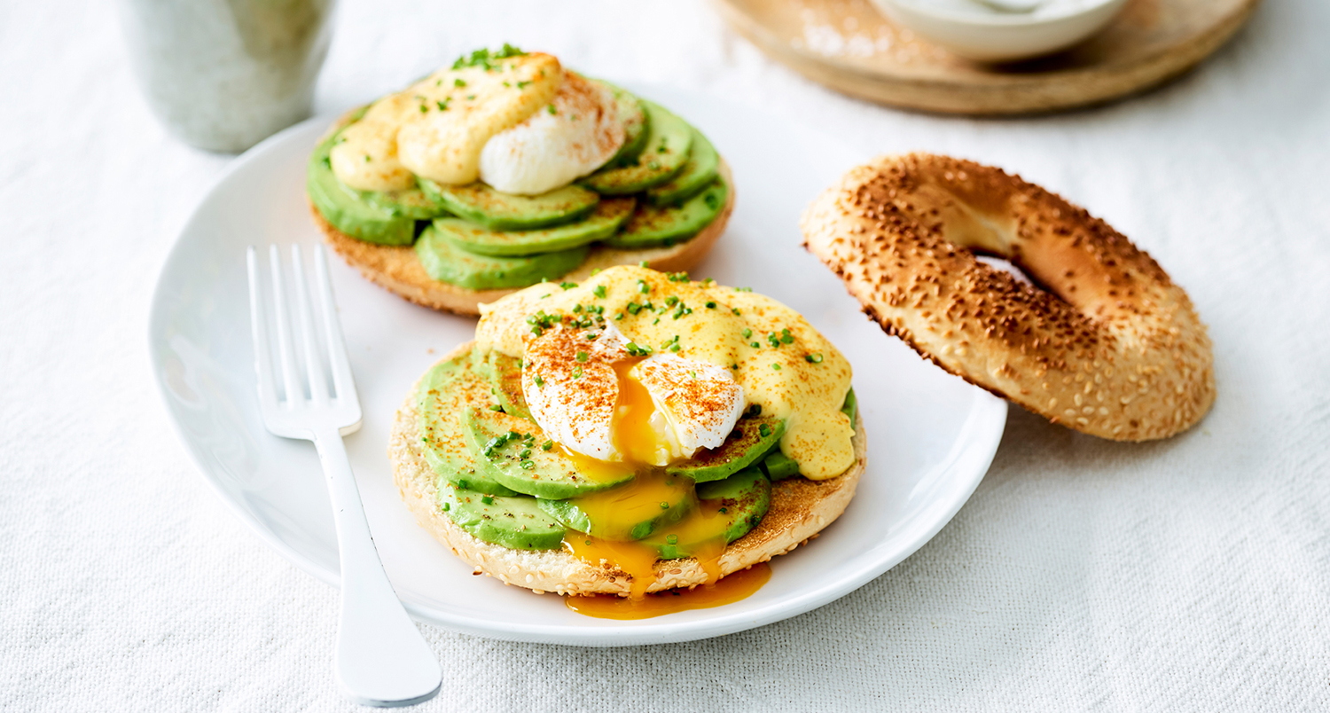bagels topped with avocado and egg