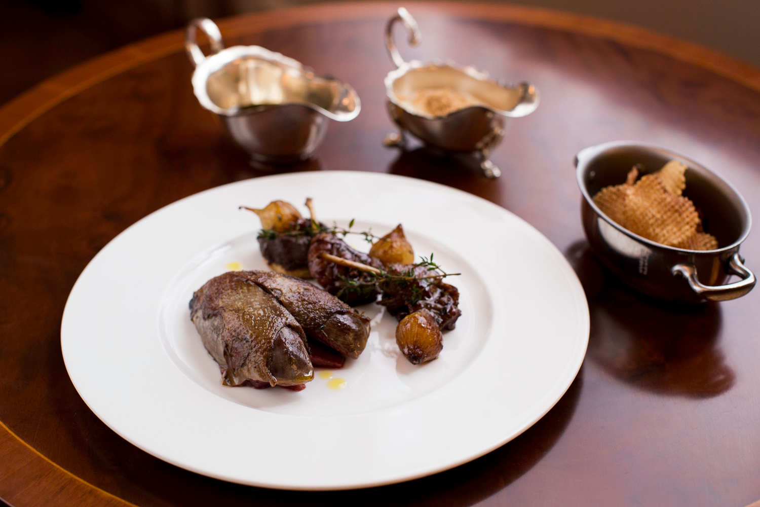 The Game Bird grouse dish with potatoes and sauces