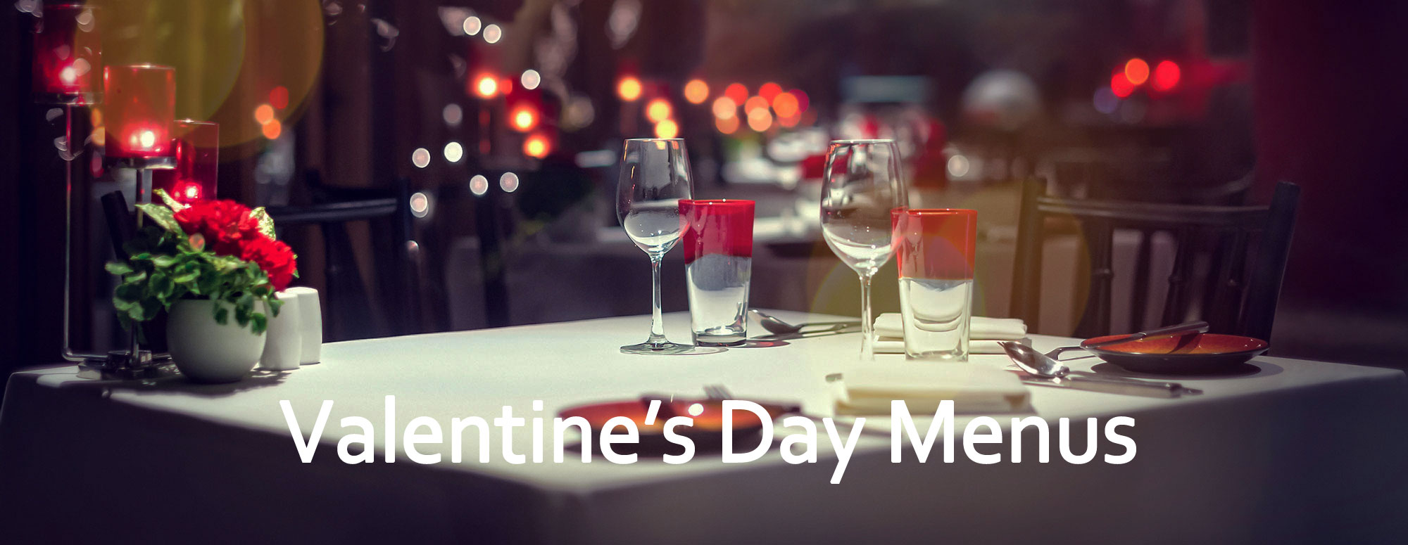 Valentine's day menus in restaurants table for two candles flowers
